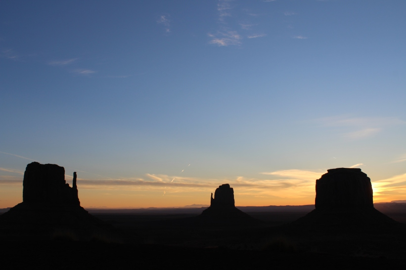 The sunrise brings peace and beauty in Monument Valley.